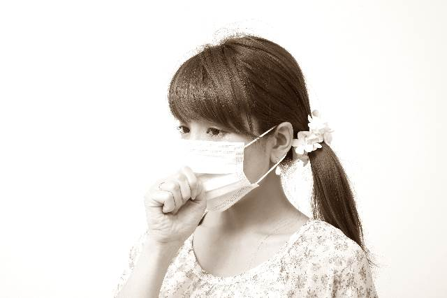 風邪を引いているママ